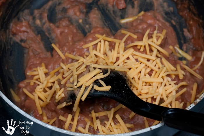 Mixing_Cheese_Refried_Beans