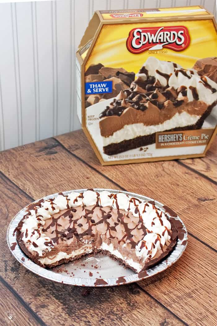 Hershey's chocolate Edwards frozen pie on table with a slice cut out.