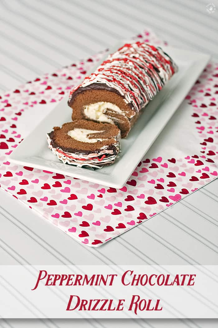 Chocolate Drizzle Cake Roll on a white serving plate.