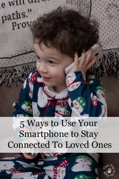 "Little E holding a Samsung Galaxy phone with the title ""5 Ways to Use Your Smartphone to Stay Connected to Loved Ones"""