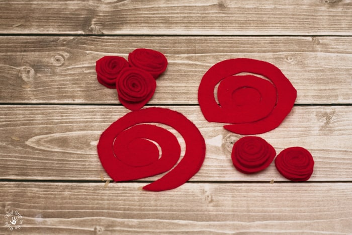 Red felt cut into spirals and glued into roses