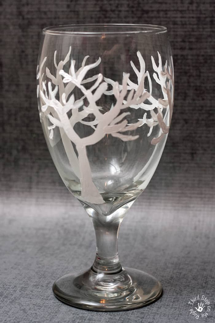 White finer tree branches painted on wine glass